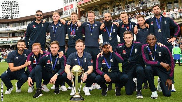 England's World Cup squad pose with the trophy