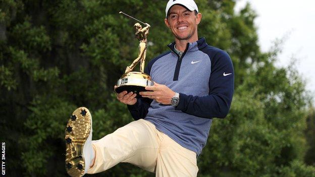 Rory McIlroy celebrates winning the Players Championship