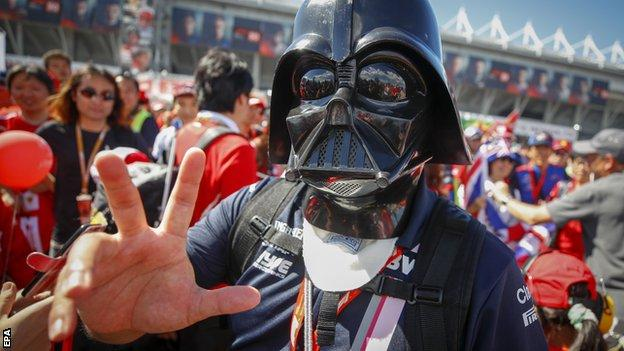 A fan at the Japanese Grand Prix dresses up as Darth Vader