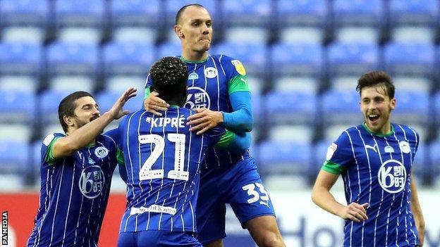 Wigan celebrate a goal
