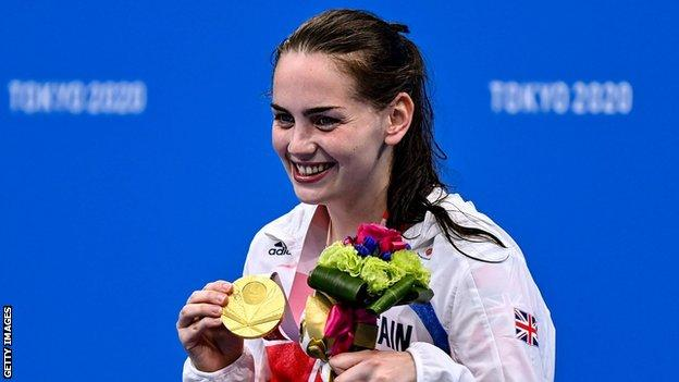 Tully Kearney smiles after setting a new world record to win the S5 100m freestyle gold medal at the Tokyo Paralympics