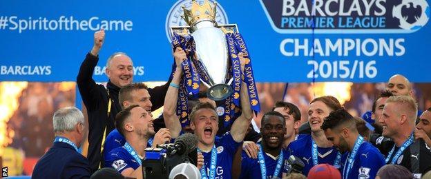 Jamie Vardy holds aloft the Premier League trophy