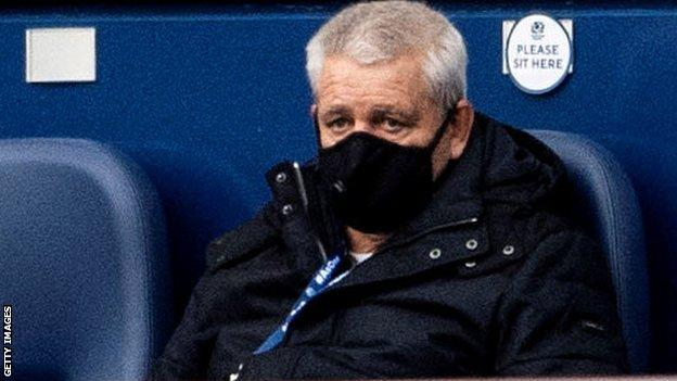 Warren Gatland wears a mask as he watches a Six Nations match at Murrayfield