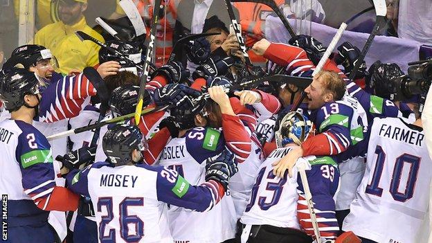 Great Britain celebrate their survival in the top flight