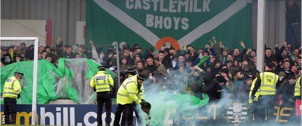 Smoke-bombs thrown by Celtic fans had to be cleared from the pitch before kick-off