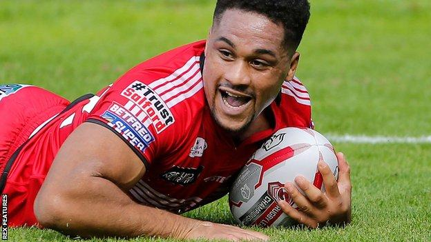 Salford's Derrell Olpherts scores a try