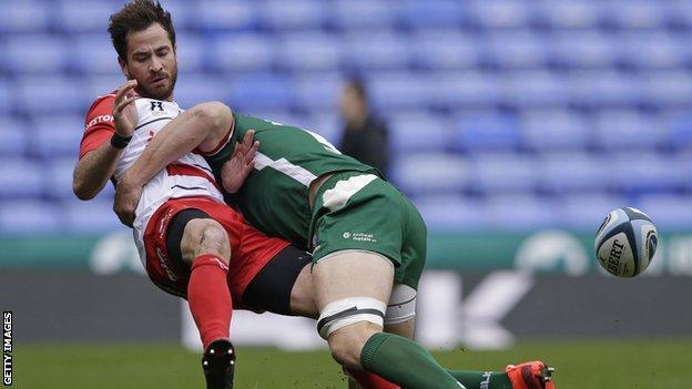 Danny Cipriani is tackled by London Irish lock Adam Coleman