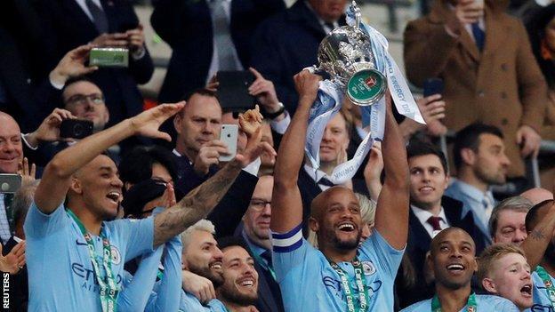 Manchester City captain Vincent Kompany lifts the Carabao Cup