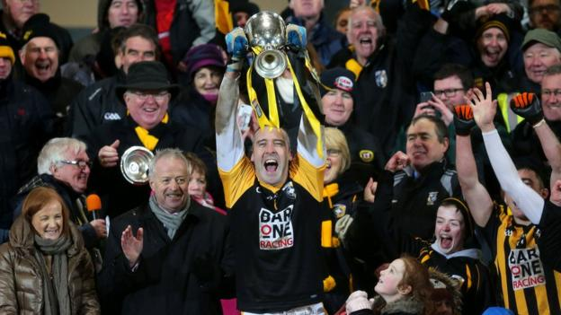 Crossmaglen captain Paul Hearty lifts the Seamus McFerran Cup after the 2-17 to 2-12 extra-time victory over Scotstown