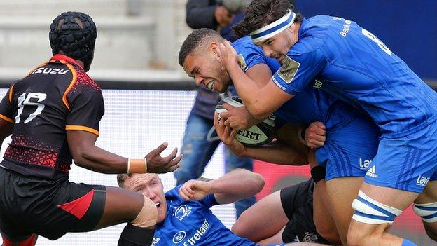 Leinster's Max Deegan supports try scorer Adam Byrne over the line