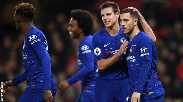 Chelsea forward Eden Hazard celebrates with his team-mates