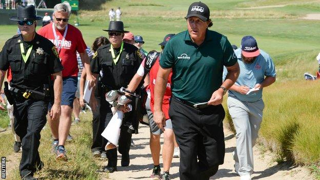 Phil Mickelson walks to the scorers hut after his third round at the 2018 US Open