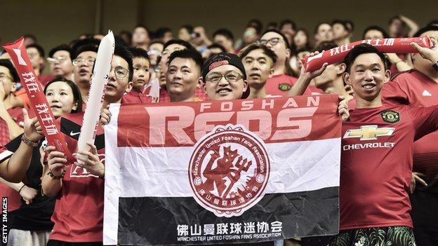 Manchester United fans in Shanghai, China