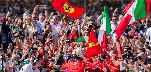 Sebastian Vettel celebrates winning the British Grand Prix at Silverstone
