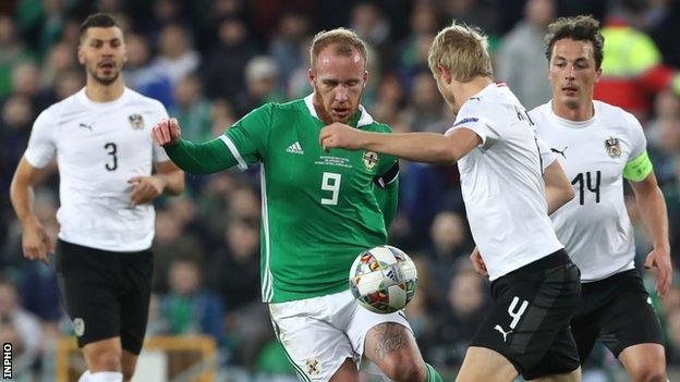 NI striker Liam Boyce in action against Austria's Martin Hinteregger