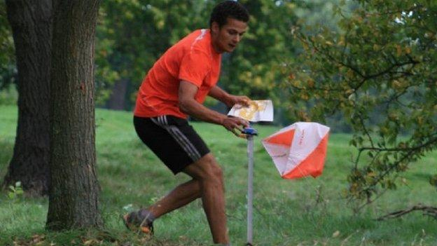 Young man taking part in Orienteering