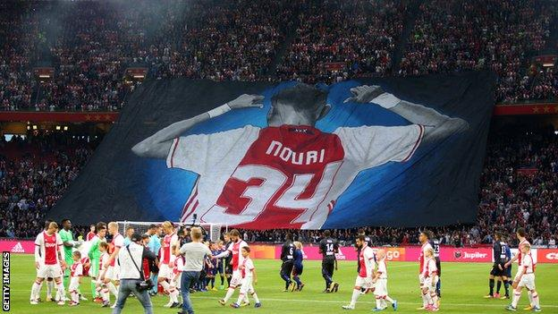 Ajax fans display a giant banner in support of Abdelhak Nouri of Ajax before the UEFA Champions League Qualifying Third Round match between Ajax and OSC Nice at Amsterdam Arena on August 2, 2017 in Amsterdam