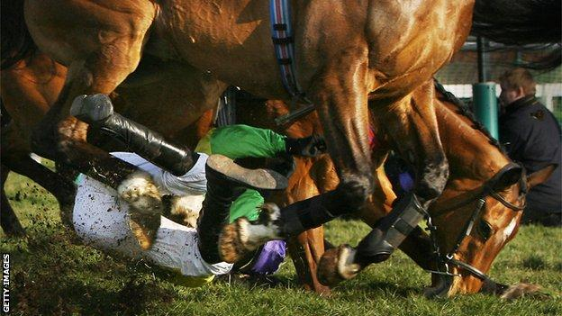 Ruby Walsh falls off Kauro Star during the 2006 Cheltenham Festival