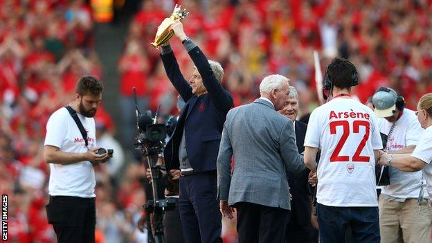 Wenger was presented with the golden trophy given to the club after their 2003-04 unbeaten 'Invincibles' season on the pitch after the match.