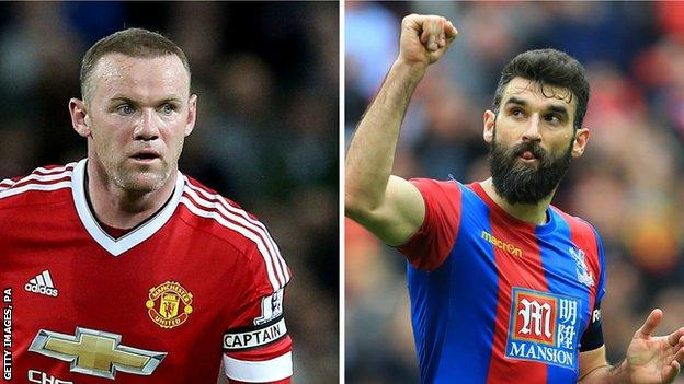 Wayne Rooney and Mile Jedinak