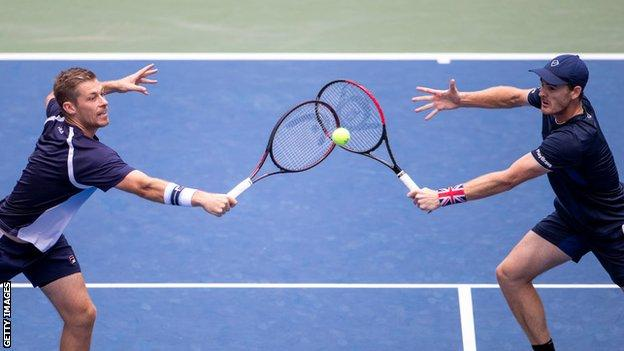Neal Skupski and Jamie Murray go for the same ball at the 2019 US Open