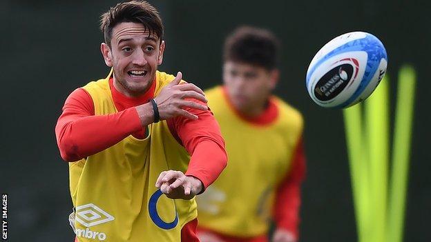 Alex Mitchell passes the ball