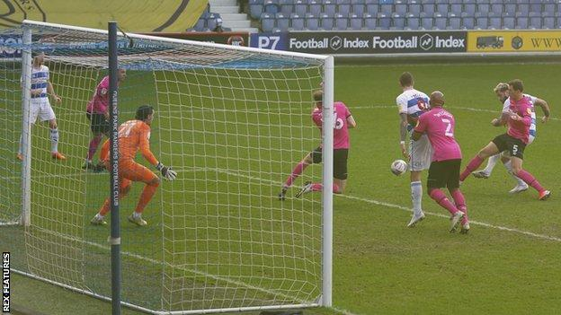 Charlie Austin of QPR has a shot well saved by Derby County Goalkeeper Kelle Roos