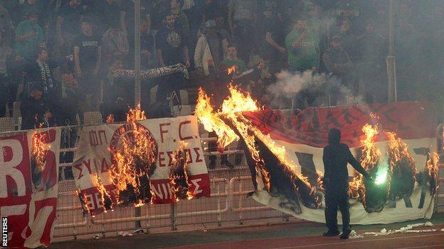 Flags burn at Panathinaikos