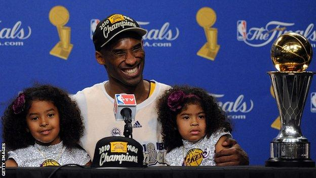Kobe Bryant celebrates winning the 2010 NBA title with his daughters Natalia and Gianna