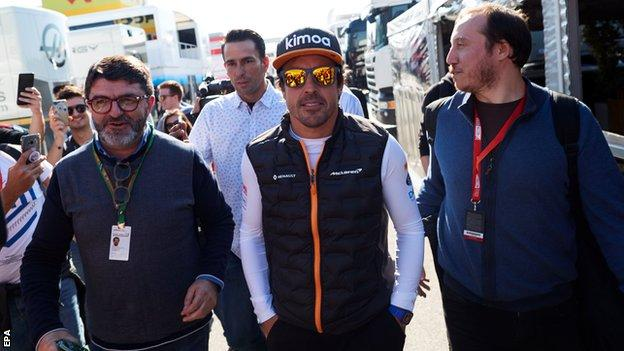 Fernando Alonso visits the McLaren garage during pre-season testing in Barcelona