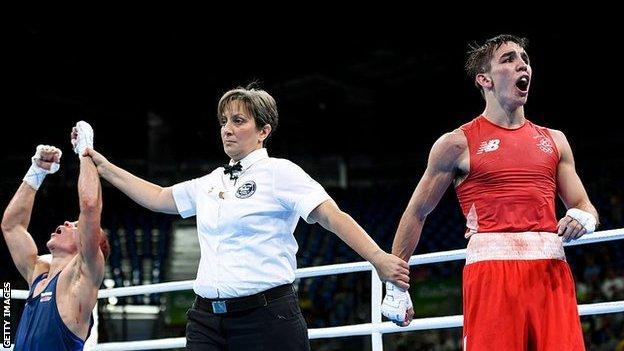 Vladimir Nikitin's arm is lifted by the ref in Rio 2016 quarter-final bout