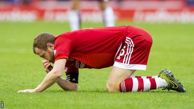 Aberdeen captain Mark Reynolds with a bleeding nose
