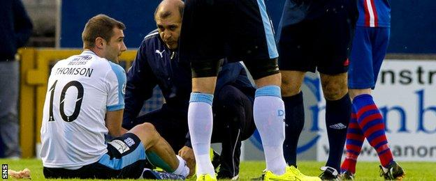 Kevin Thomson receives treatment while with Dundee