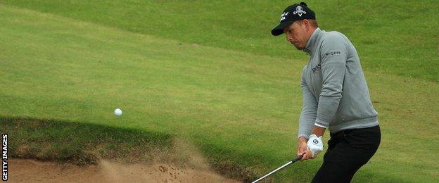 Hnerik Stenson playing out of a bunker on the 16th hole
