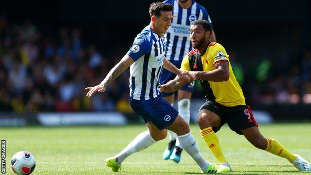 Lewis Dunk tackles Troy Deeney