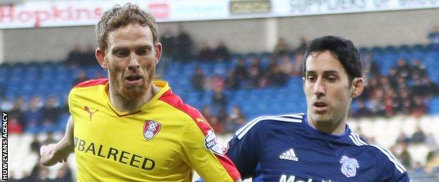 Rotherham's Paul Green takes on Cardiff's Peter Whittingham