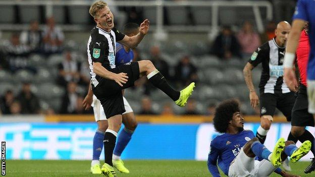 Matt Ritchie (left) suffers his injury against Leicester