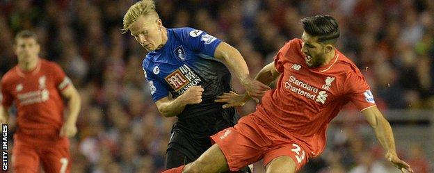 Bournemouth's Matt Ritchie challenges Liverpool's Emre Can