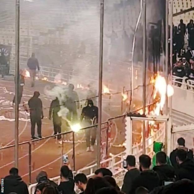 Fans with flares in the stadium