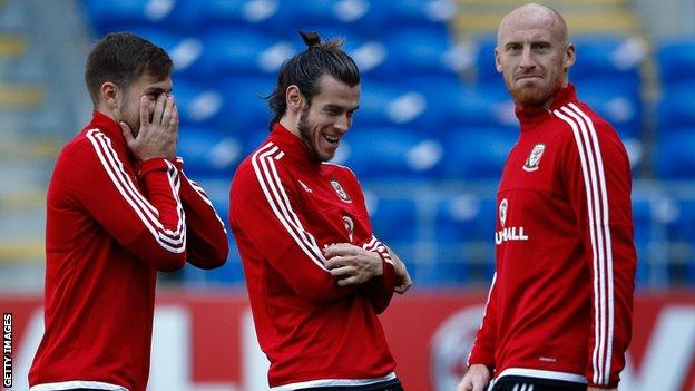 James Collins (right) pictured with Aaron Ramsey and Gareth Bale