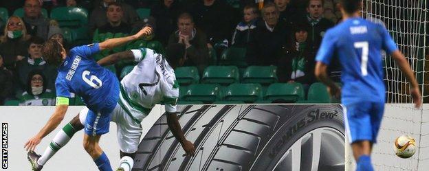 Daniel Berg Hestad of Molde beats Celtic's Tyler Blackett to the ball to score