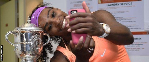Serena Williams poses for a selfie with the Suzanne Lenglen trophy after winning this year's French Open