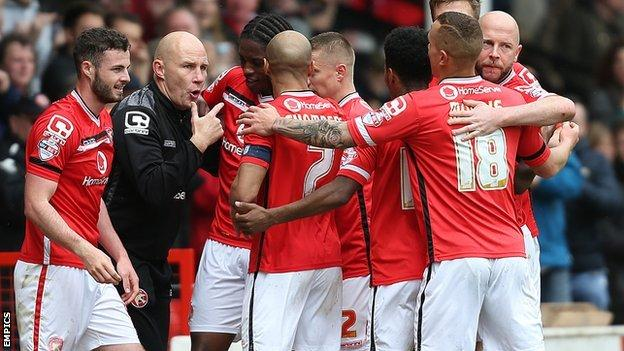 Walsall's players ran to the side of their pitch to celebrate their third goal against Fleetwood on Monday with boss Jon Whitney