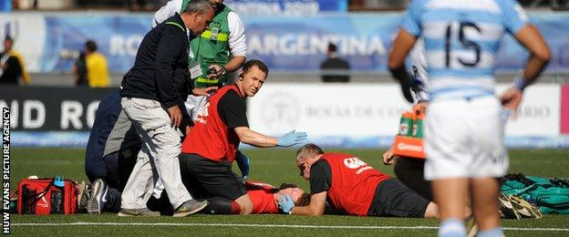Aneurin Owen receiving treatment for a head injury in the match against Argentina