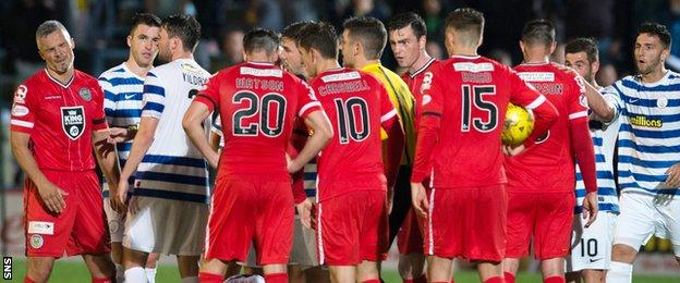 The Morton and St Mirren players exchange views after an incident involving Jim Goodwin