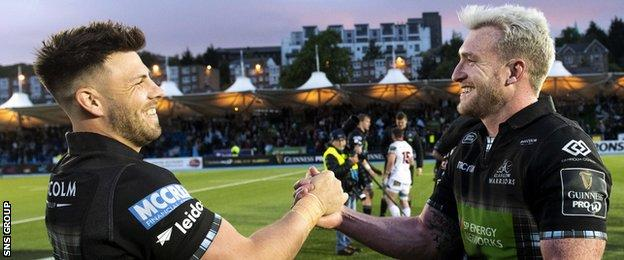 Ali Price celebrates with the departing Stuart Hogg at full-time