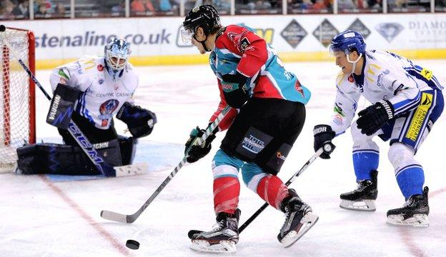Coventry goalkeeper Brian Stewart tries to keep out Michael Forney of the Belfast Giants