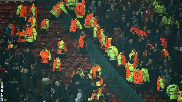 Liverpool and Manchester United fans during a Europa League game.