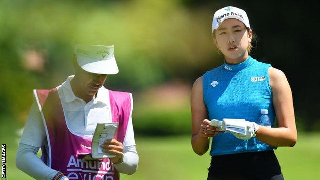 Joint leader Yealimi Noh discusses a shot with her caddie on the 18th