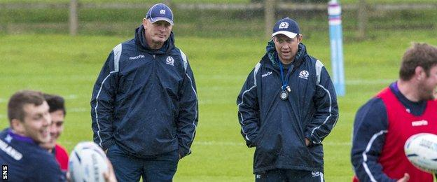 Scotland head coach Vern Cotter and assistant coach Matt Taylor watch the players train in Gloucester